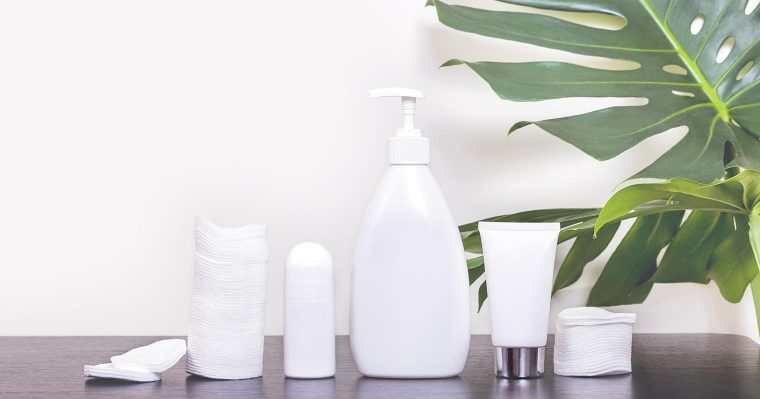 white bottles carrying skincare products