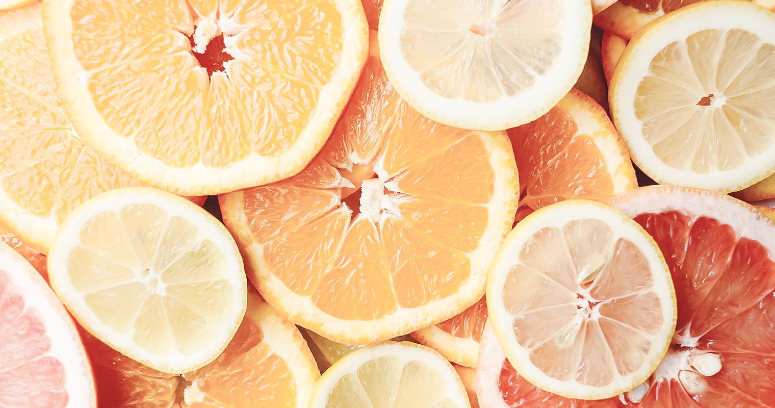 cut oranges with vitamins