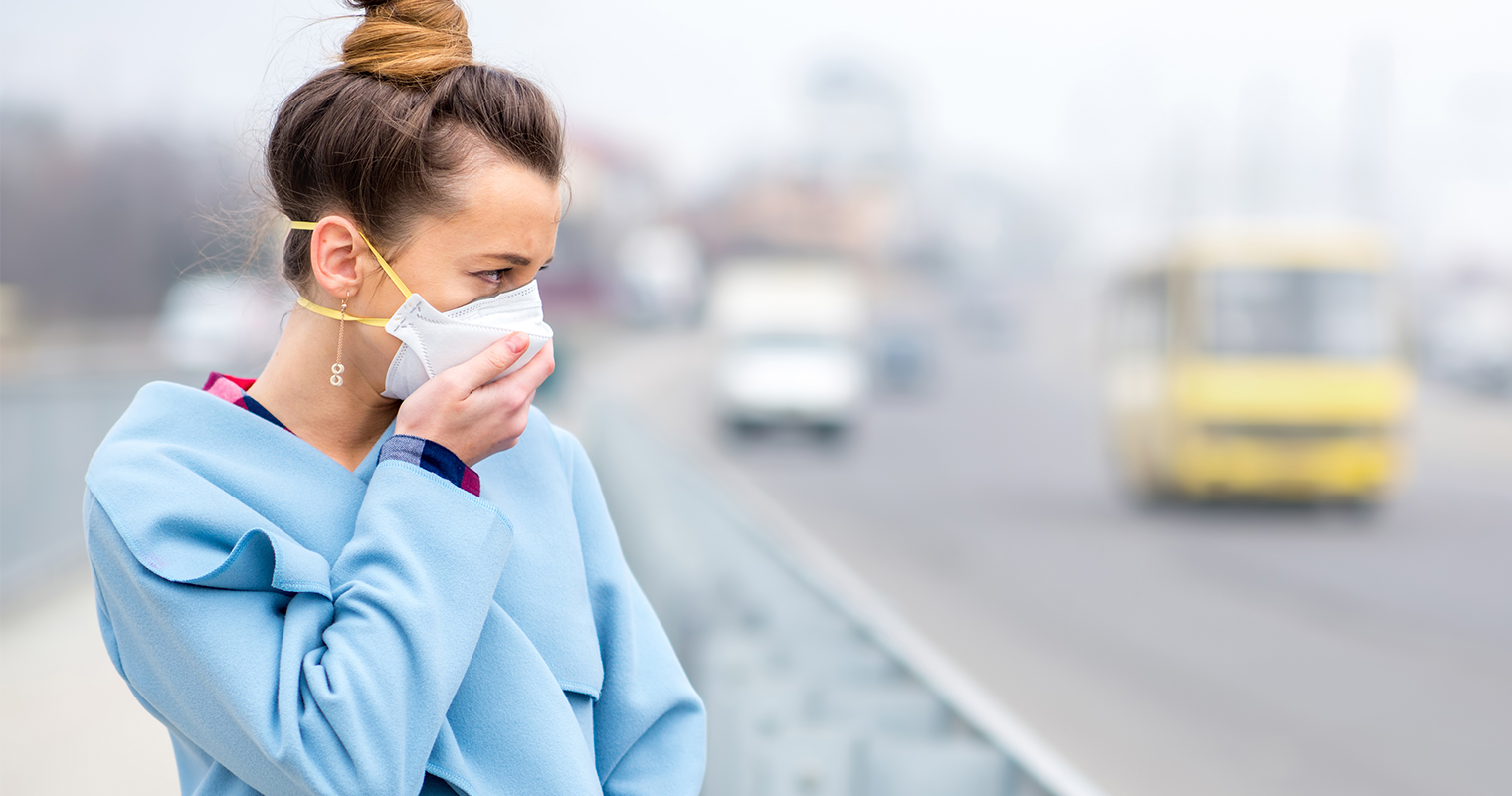 woman wearing a face mask to protect against air pollution and dust