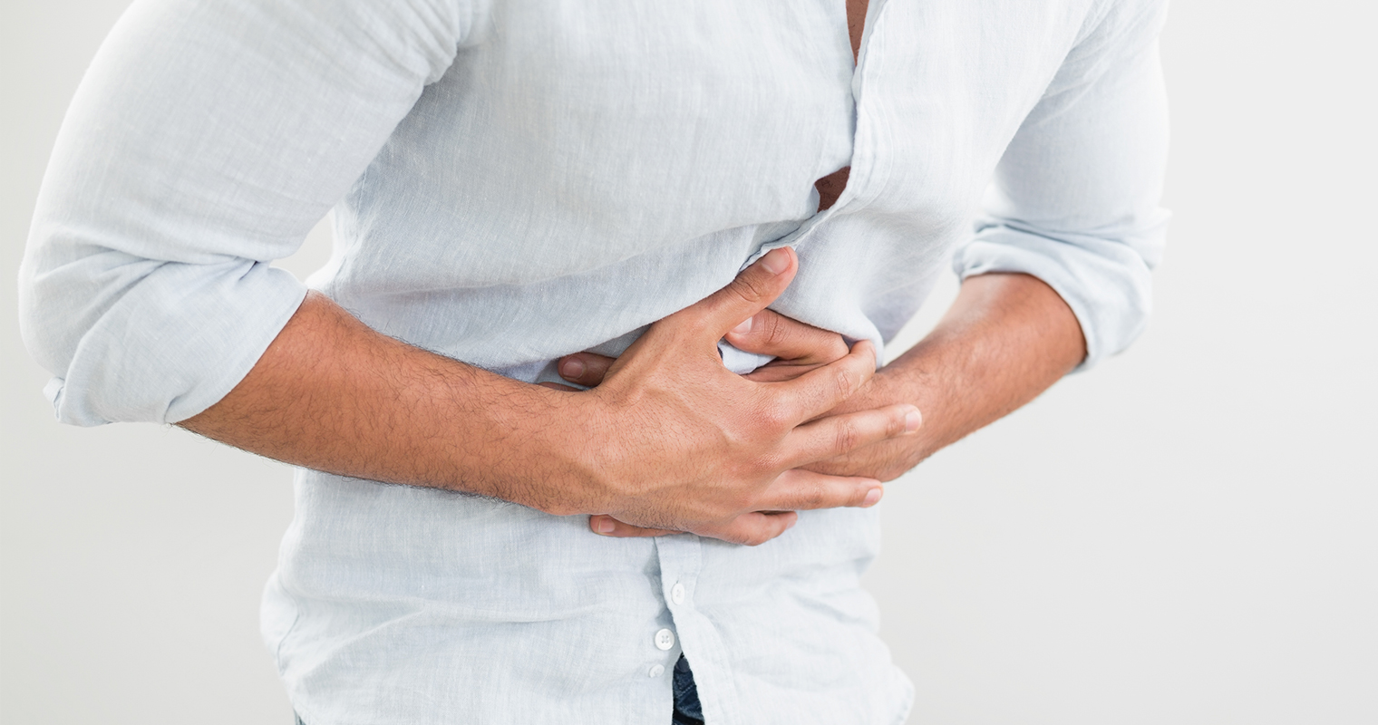 man suffering from tummy pain