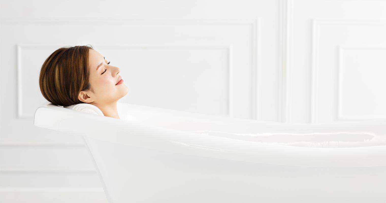 woman relaxing in lukewarm water bath